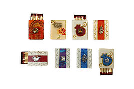 Shabbat matcboxes, napkin stand, table cloth, wine sttopers