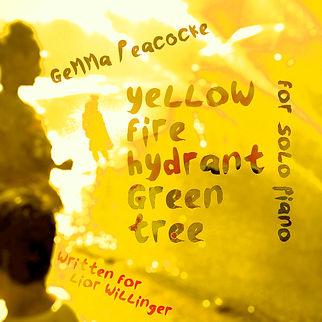 Yellow fire hydrant green tree.jpg