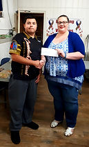 MHDL Presient Carrie Stotz presentingSoutheast Alberta Youth Darts player, Mykel  Kequahtooway cheque for $250.00.