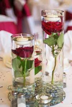 rose in cylinder vases