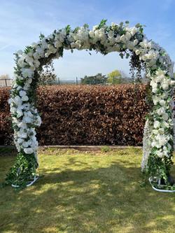 Ivory floral wedding arch