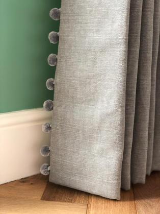Grey fabric from Romo with a pom pom trim to add a bespoke look