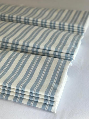 Three roman blinds made up in a Susie Watson blue stripe.