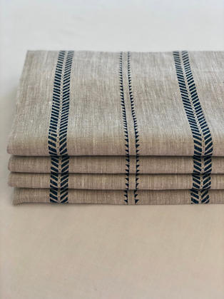 A natural basecloth with navy stripes