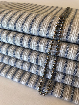 Roman blinds made up from clients old curtains.