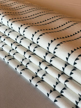 A stunning Zoe Glencross stripe makes perfect roman blinds.