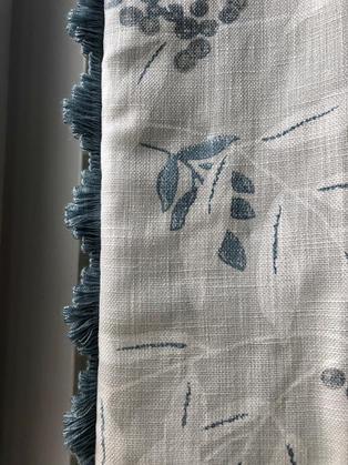 Adding a trim to a curtain adds a truly bespoke look. Fabric by Laura Ashley and fan edge trim by Troynorth.