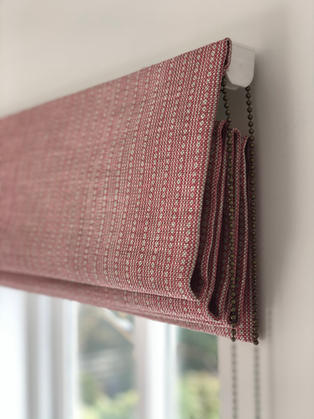 Blithfeild fabric roman blind hanging on a child safe cassette with a bronze chain.