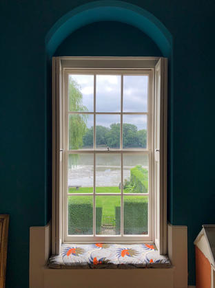 Bespoke window seat cushion cover in this gorgeous arched window.