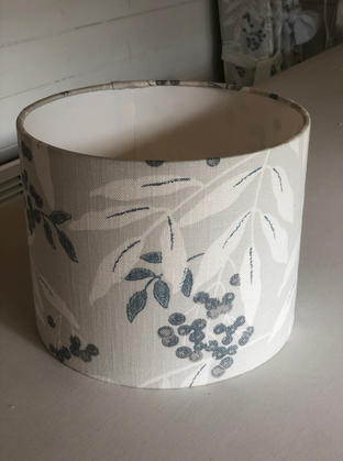 Lampshade made up in Laura Ashley fabric to match some curtains and bring a room scheme together.