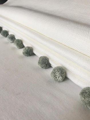 Ivory herringbone fabric from Warwick