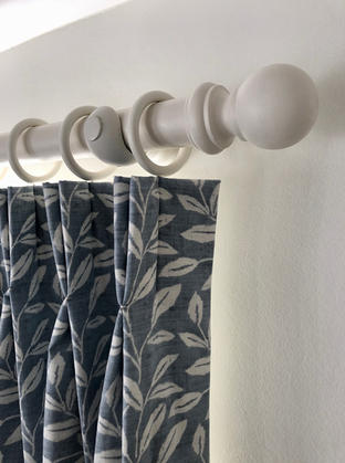 Double pleat curtains in Studio G Terrace trail fabric with a chunky white pole