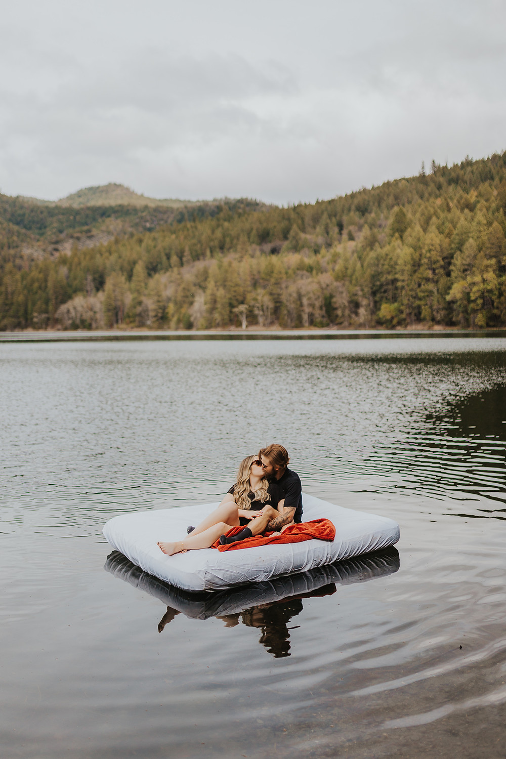 Couple floating on a lake in Southern Oregon