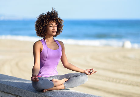 Black woman, afro hairstyle, doing yoga