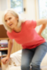 Mid age woman with backache.jpg