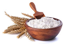 flour with wheat in a wooden bowl and sh