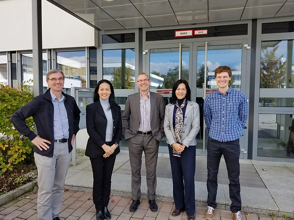 Robin Lee and Helen Lee with engineers in Germany