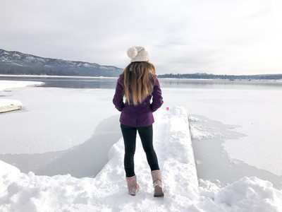 girl walking on frozen lake