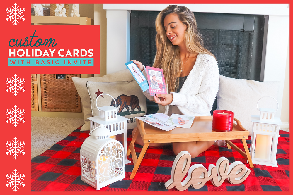 girl choosing holiday cards in front of a fireplace