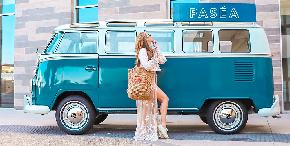 girls standing in front of blue Volkswagen van