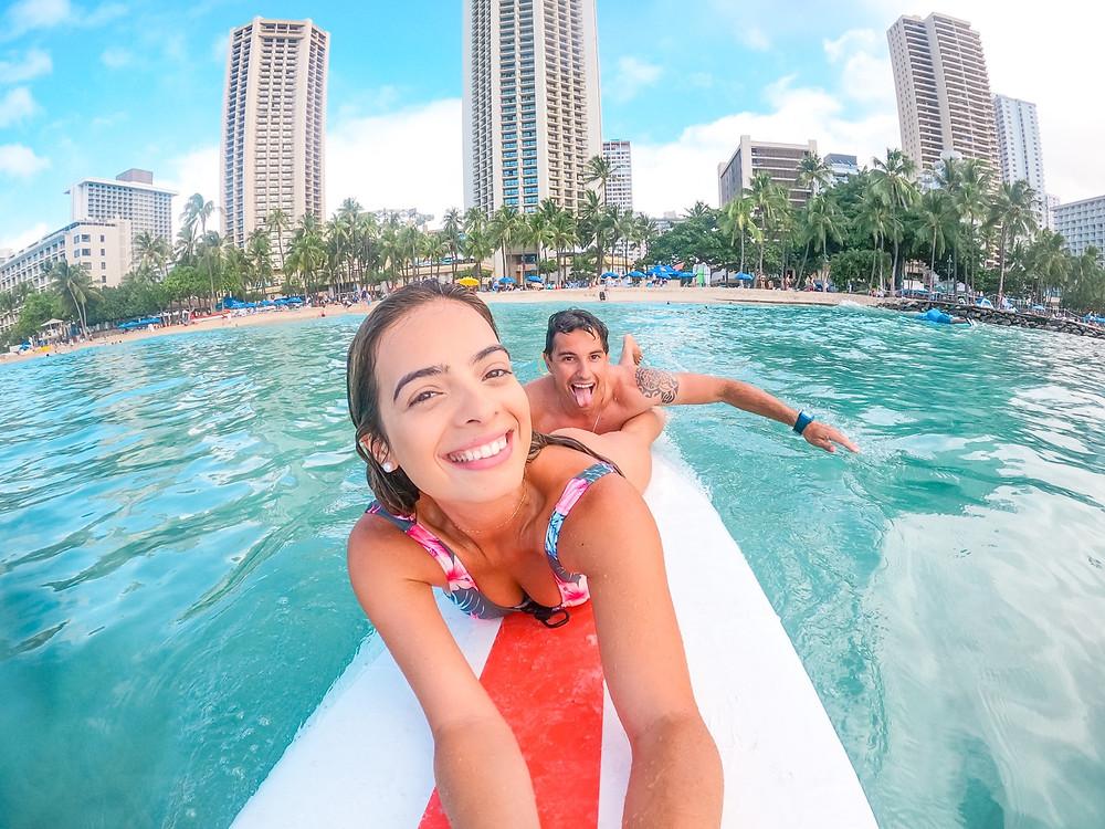 couple surfing in Waikiki Hawaii