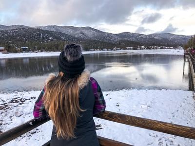 girl looking at frozen lake