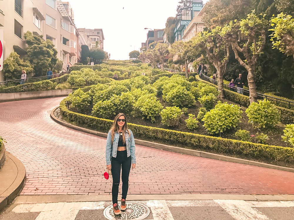girl standing on San Francisco lombard street