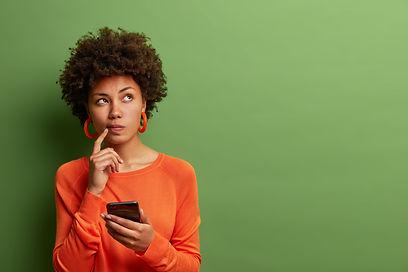 Photo of pretty ethnic woman ponders on