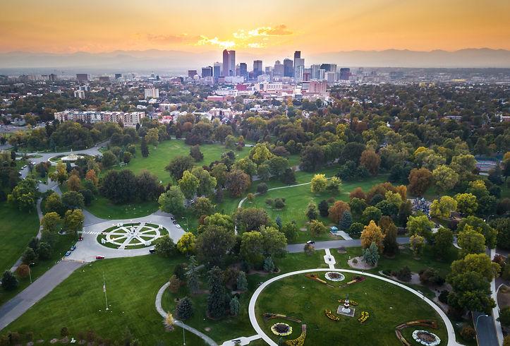 Sunset over Denver cityscape, aerial vie