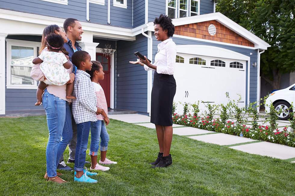 Real estate agent showing a family a hou