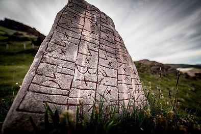 a-rune-stone-on-a-hill-in-qassiarsuk-in-
