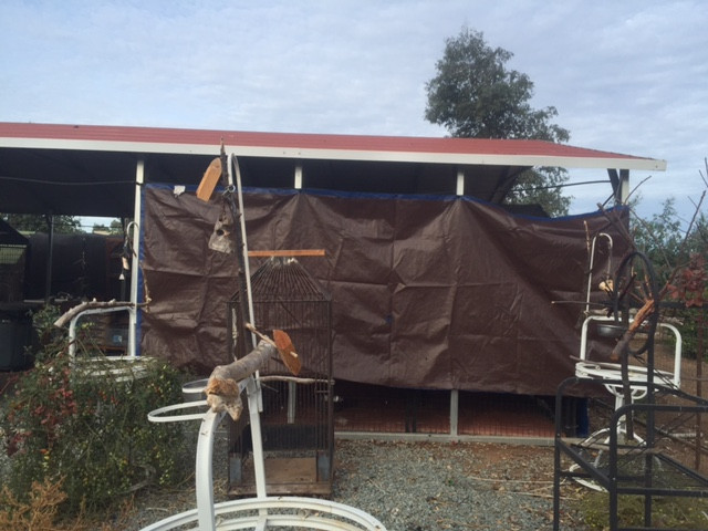 Tarp on the side of A-frame aviaries