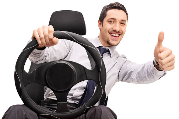 Young guy driving and giving a thumb up