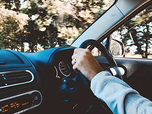 person-holding-black-vehicle-steering-wh