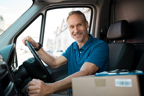 Delivery%20man%20driving%20van%20with%20