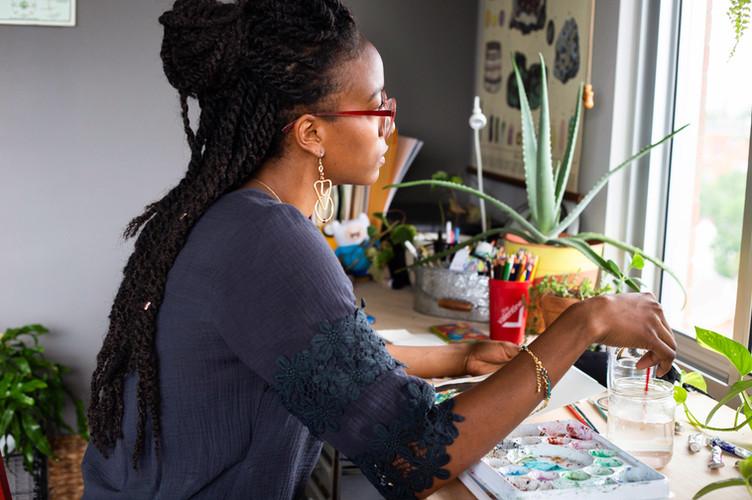 Sitting at my studio desk. Photo by Bridget Burnett.