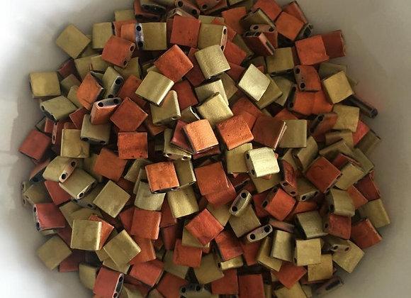 5g Miyuki Tila - Black California Gold Rush Matted - 5x5x1.9mm - TL55046