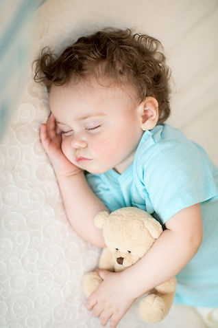 Adorable child boy sleeping in bed, hold