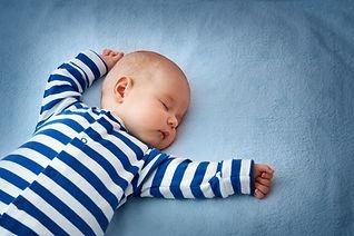 Baby sleeping in bed.jpg