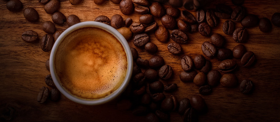 coffee cup with coffee beans arond