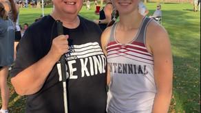 Carol Flickinger  at a track meet with her granddaughter!