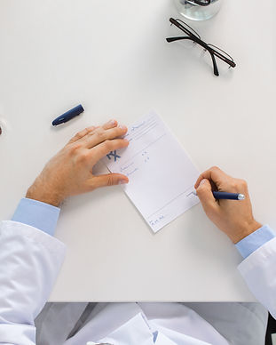 doctor-hands-with-prescription-at-clinic