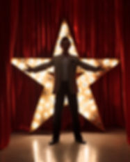 Man on stage with star on background.jpg