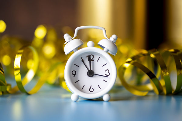 front-view-white-clock-ribbon-golden-bac