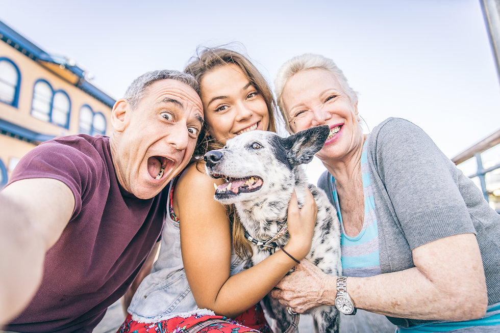 Self portrait of happy family with dog h