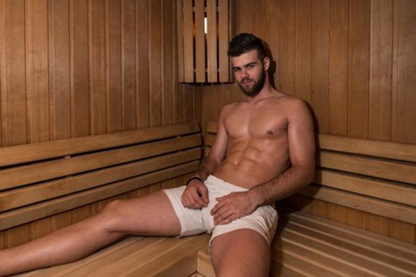 Male sat in a sauna wearing white shorts