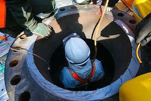 Confined space entry by a worker who wea