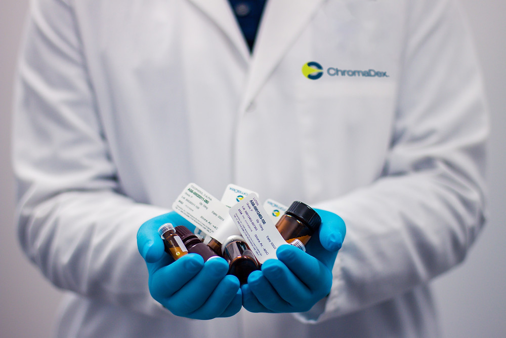 A researcher holding trial medications
