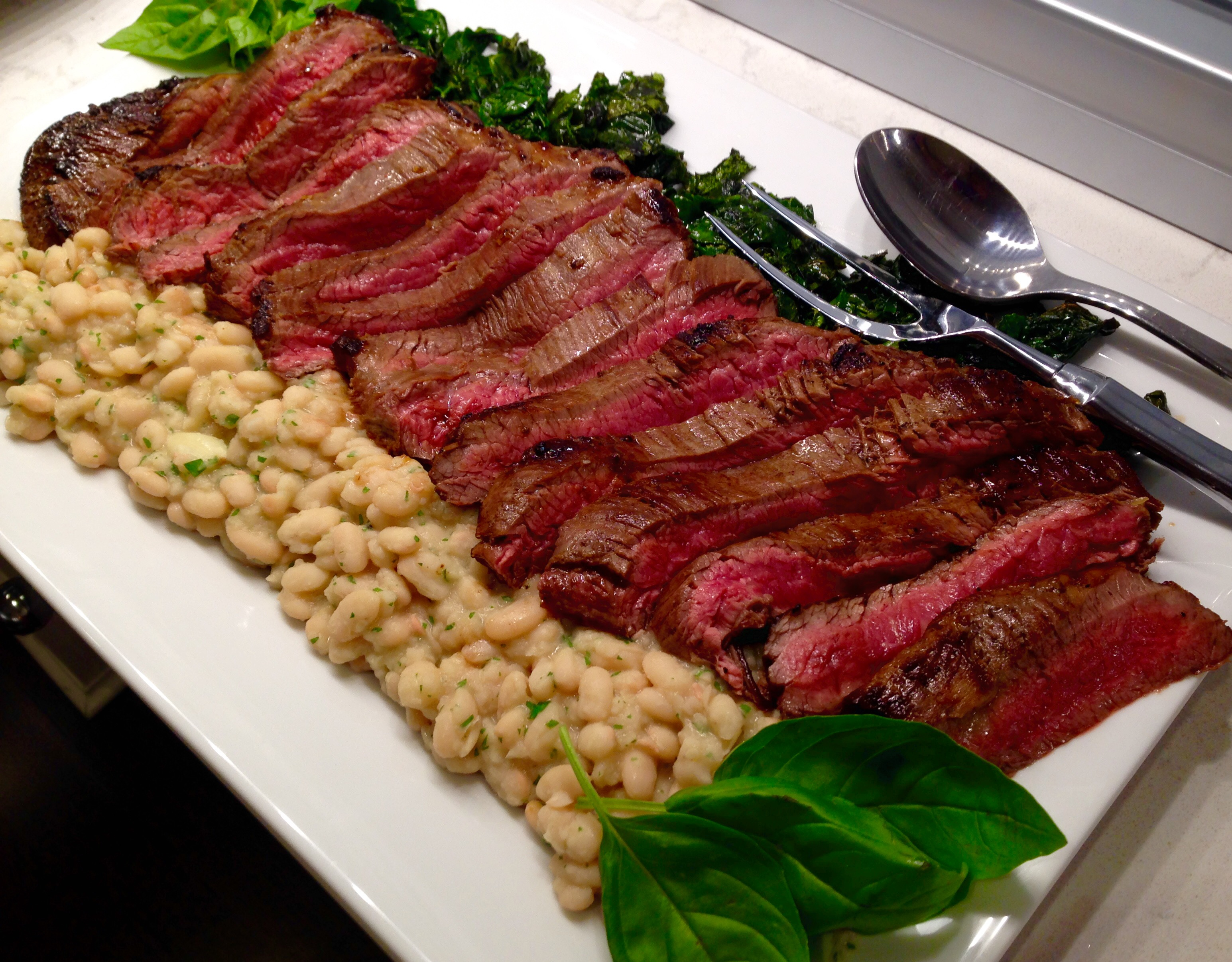 Beef tagliata with white beans and Tuscan kale
