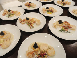 Scallops with caviar plated